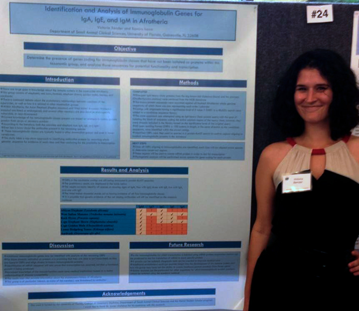 student with poster at merial research symposium presentation 2013 at michigan state university